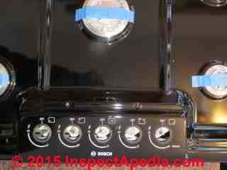 Bosch gas cooktop with gas burner control knobs removed (C) Daniel Friedman