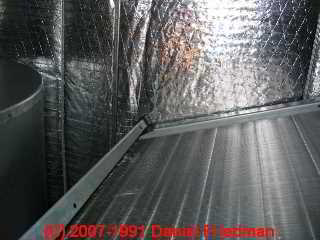 Photo of foil covered fiberglass insulation inside an HVAC air handler (C) Daniel Friedman