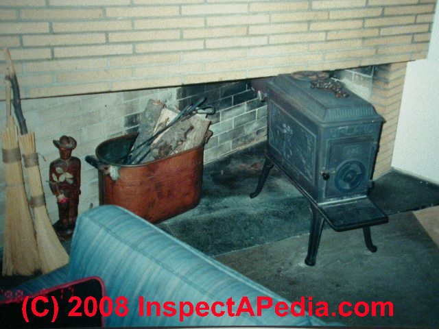 venting a wood stove through a fireplace 2