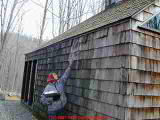 Photograph of leaky wood shingles on a home exterior.