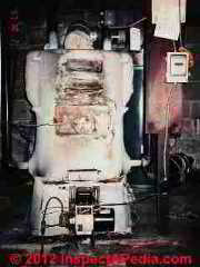 Hardcast asbestos on heating boiler (C) D Friedman