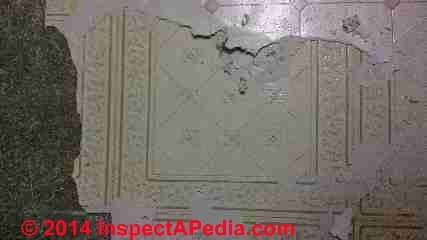 Peel and stick floor beneath sheet flooring from early 1980's (C) InspectApedia.com