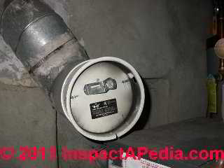 Oil fired water heater with a backpressure sooting problem (C) Daniel Friedman