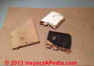 Fiberboard insulation fragments used under bowling alley lanes (C) InspectApedia
