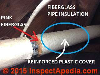 Fiberglass insulation on heating pipes (C) InspectAPedia.com