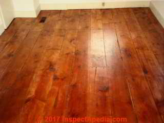 Gaps left in antique wood floor © Daniel Friedman