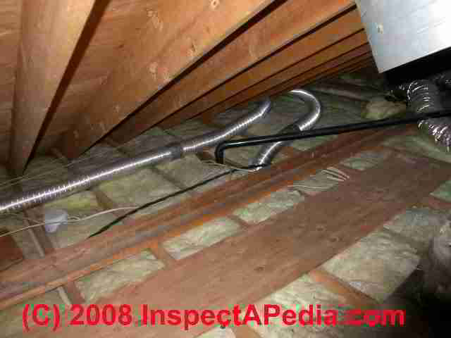 Vent fan spilling into attic (C) D Friedman Uninsulated fan ducts in an  attic (C) Daniel Friedman
