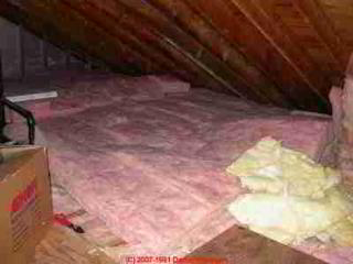Fiberglass insulation added in an attic  (C) Daniel Friedman