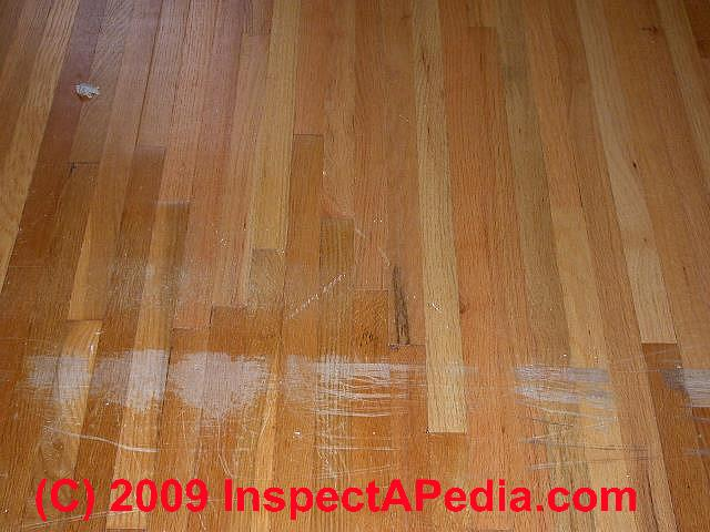 Scratched oak flooring © Daniel Friedman - Wood Floor Types, Damage, Diagnosis & Repair Damaged Wood Floors