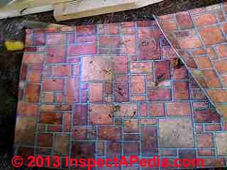 Red brick pattern sheet flooring (C) InspectAPedia.com
