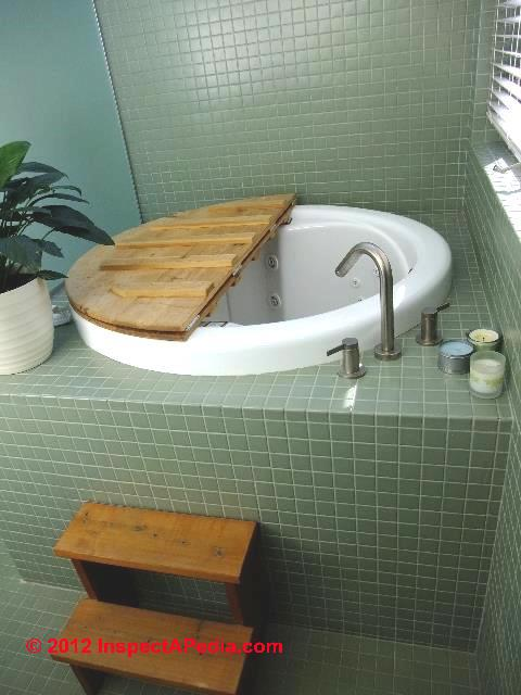 Small Japanese Soaking Tub with Shower-inspectapedia.com