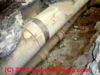 Photo of tranite cement-asbestos material used for air ducts in a slab over a sewer pipe (C) Daniel Friedman and Conrad