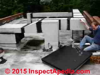 Low slope roof inspection (C) Daniel Friedman