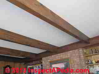 Original flat ceiling is retained with a roof-structure-over roof conversion from flat to pitched slope (C) InspectApedia