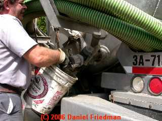 PHOTO of opening the septic pumper truck tank valve cover.