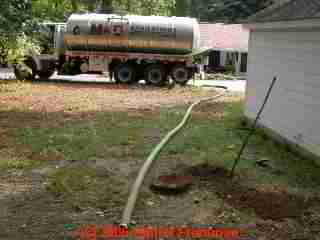 PHOTO of septic tank pumping vacuum hoses placed at the site