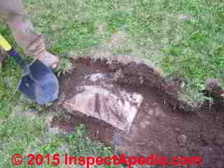 Septic tank cover found just a few inches below ground (C) Daniel Friedman