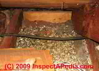 Vermiculite insulation in this attic ceiling may contain asbestos fibers.