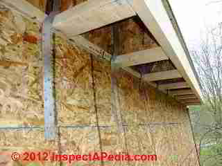 I Joists nailed outside of framed wall © D Friedman at InspectApedia.com