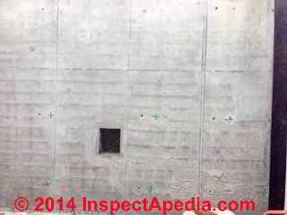 Dark parallel horizontal lines in a newly placed concrete wall (C) InspectAPedia CI
