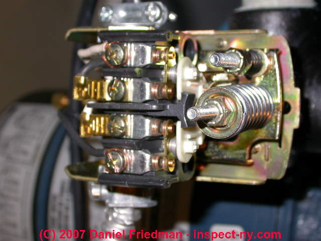 how to replace a water pump pressure control private pump and photo of the interior of a water pressure control switch showing the electrical contacts