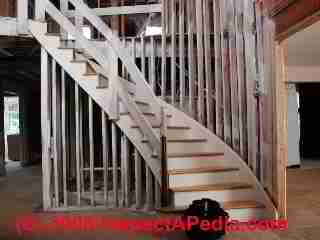 Photo of a stairwell and entry floor of a home following demolition and cleaning for flood and mold damage (C) Daniel Friedman