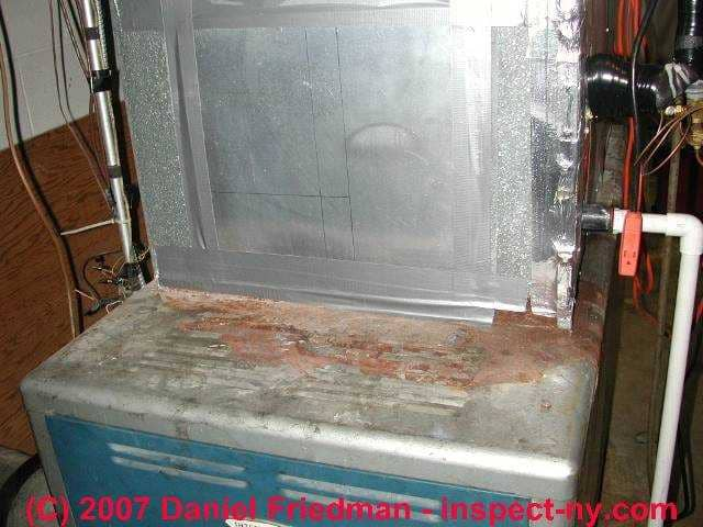 Photograph Of Rust On A Furnace Warning Unsafe Heat Exchanger