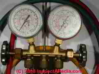 Photograph of a commercial air conditioning compressor charging gauge set (C) InspectAPedia.com