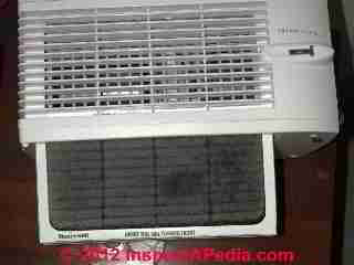 Room air conditioner filter cleaning (C) Daniel Friedman