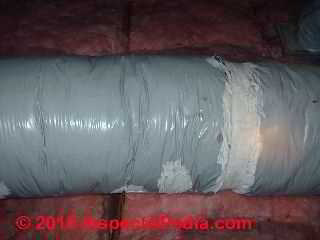 Photograph of  heat-deterioration of Goodman Gray Flex Duct in an attic