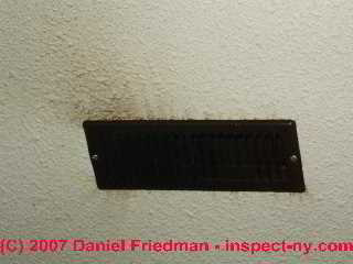 Photograph of supply register with soot or debris stains at a ceiling.