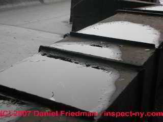 Photograph of rooftop ducts leak water into fg lined duct