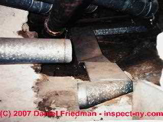 Photograph of disconnected air conditioning duct in a crawl space