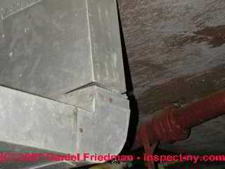 Photograph of loose supply duct connection metal duct work