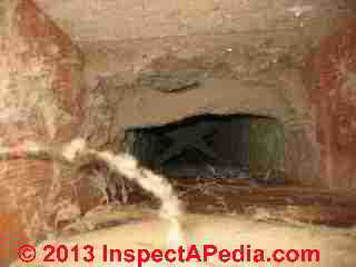 Fiberglass insulation in an air handler (C) Daniel Friedman