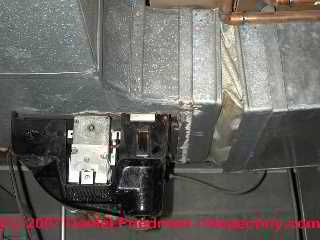 Photograph of asbestos fabric on an air conditioning and heating blower vibration damper