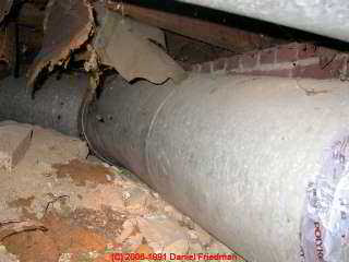 Photograph of  this ugly duct routing risking water entry, mold, rodents, high operating cost.