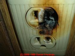 Photograph of an overheating aluminum-wired electrical outlet - thanks to J Simmons.