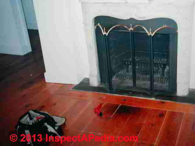 Our photo (left) shows a burned wooden floor in front of a fireplace hearth.