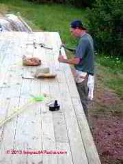 Setting nails in 2x6 decking at the SummerBlue Arts Camp, Two Harbors MN (C) Daniel Friedman