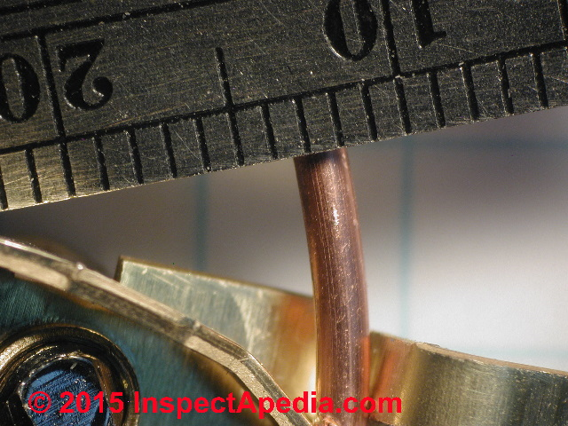 Electrical wire sizes diameters table of electrical service entry close up measurement of the diameter of a 14 copper electrical wire c greentooth Gallery