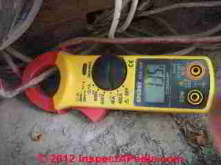 A W Sperry Instruments Digisnap DSA-500 digital multimeter with snap around ammeter in use at the electric meter (C) Daniel Friedman