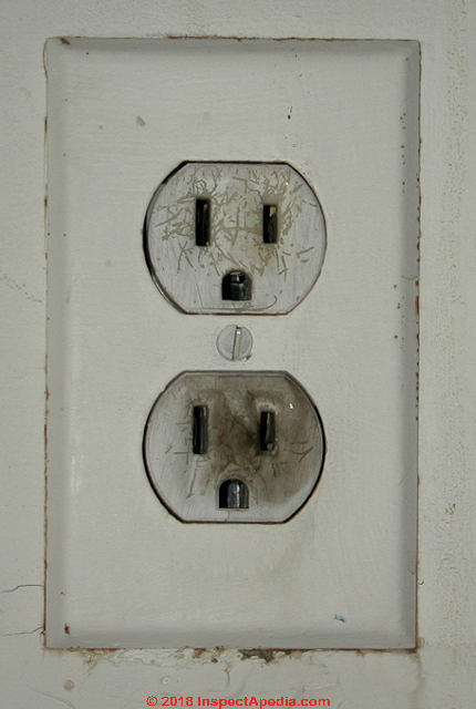 Burned Electrical Receptacle With Ground Connector Down C Daniel Friedman At InspectApedia
