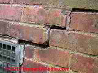 Step cracks in brick wall  (C) D Friedman