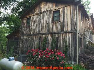 Black stains on cypress board siding, Arkansas (C) InspectApedia RH