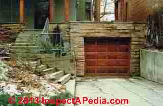 Basement-Garage with in-slope driveway invites basement flooding (C) InspectAPedia Carson Dunlop Associates