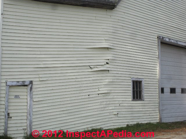 Vinyl Siding Damaged By Building Structural Movement