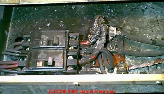 Photograph of Heater circuit burnup, FPE breaker failed to trip
