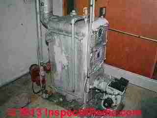 Heating boiler with most asbestos insulation removed (C) Daniel Friedman