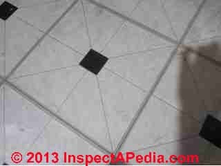 Possible asbestos containing self adhesive Emerald Vinyl Floor Tiles (C) InspectApedia.com